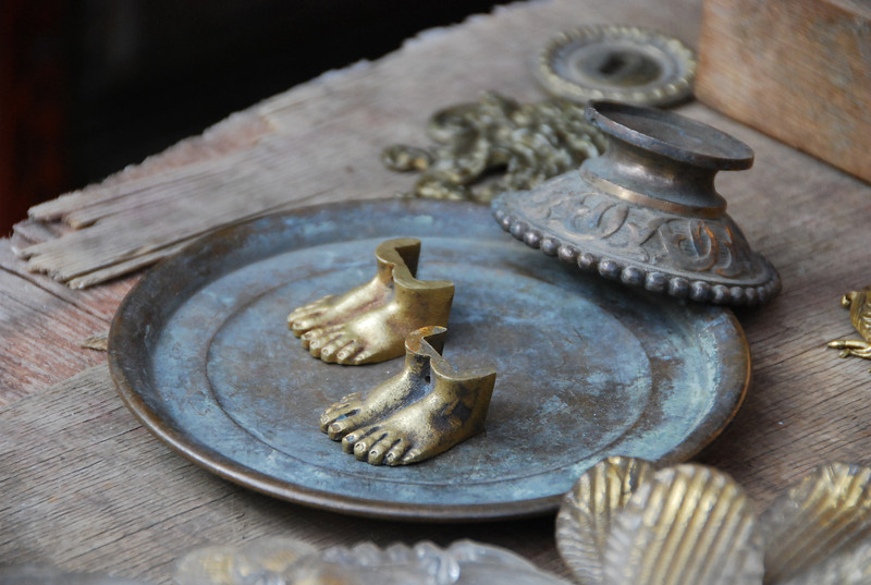 Brass feet on copper tray, Clignancourt Flea Market, Paris, 2011.