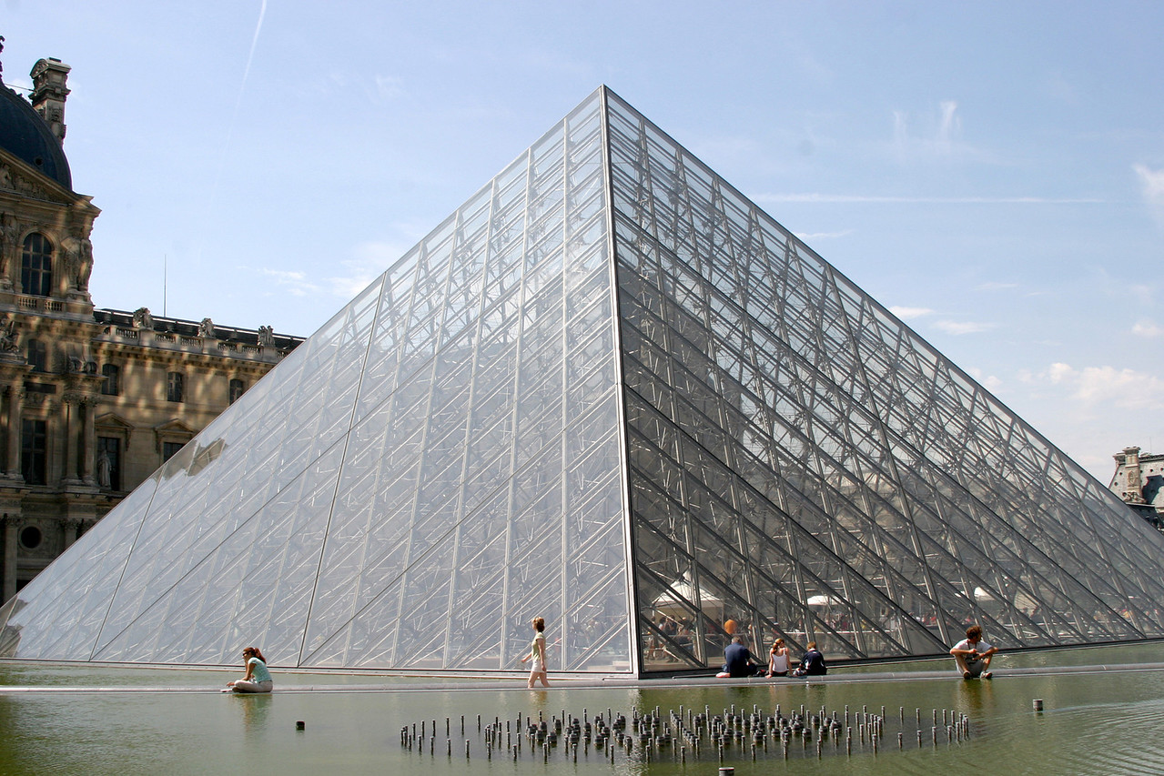 The pyramid just outside the Louvre in Paris. The Louvre palace and art gallery museum. The Louvre is one of the largest and most visited art museums in the world.