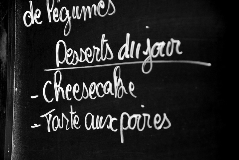 Desserts of the day listed on l'ardoise at a Paris café. 2013.