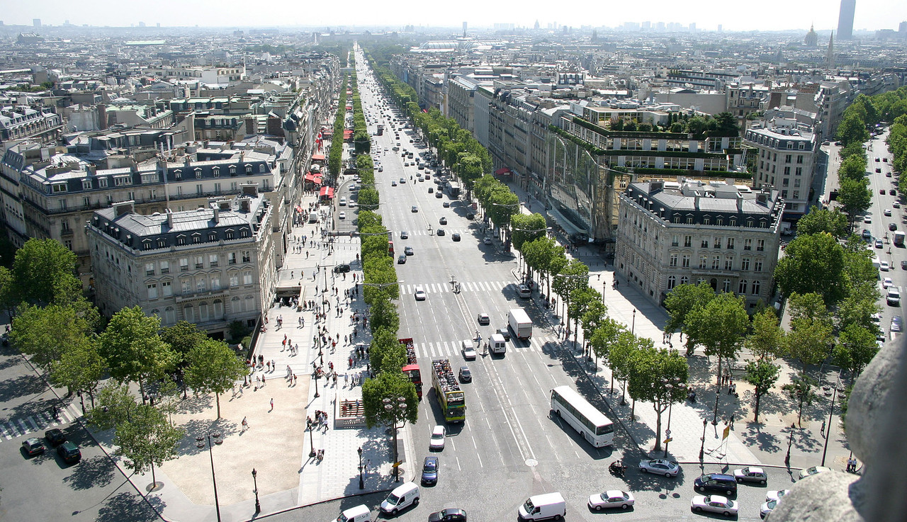 View of Avenue des Champs-Élysées main shopping street in Paris) from the top of Arc de Triomphe. The Avenue runs for 1.18 miles with cinemas, cafes and luxury shops.