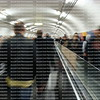 Fast moving blurred people walking in the people mover in Paris