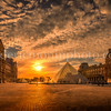 Sunset on the Pyramid of the Louvre in Paris