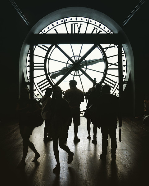 Silhouettes at the Musée d'Orsay Clock. 2016.