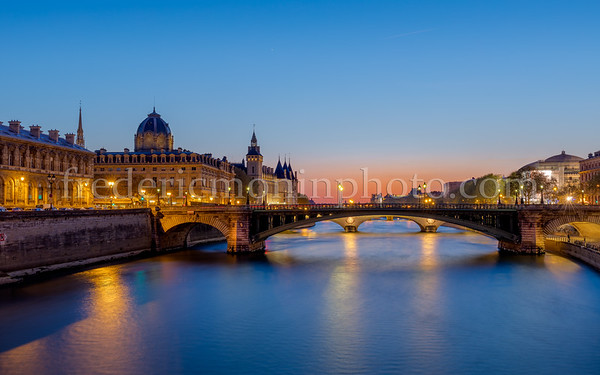 Blue hour on the Conciergerie along the Seine in Paris
