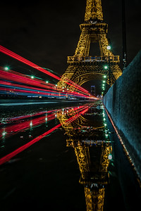 Reflection of Eiffel Tower at night.