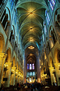 Interior during the day is lit up by the light through the stained glass windows.