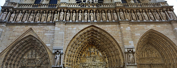 The cathedral is too wide for my wide angle lens so I made a 3 shot panorama of all three doors.