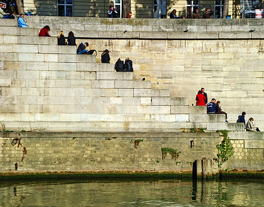 Taken from a Seine River cruise boat, I liked the composition of this photo with the diagonal of young people sitting by the water.