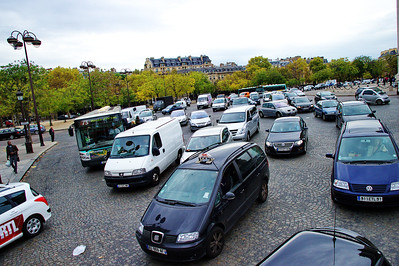 There are multiple rows of cars converging around the Arc de Triomph and a traffic nightmare. Of the many times we went by it on the bus or with friends in their car, I never saw an accident. Amazing!