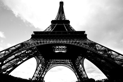 The Eiffel Tower is painted brown and ugly color.  I converted this photo to B&W which is more appealing to me.