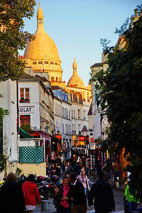 Montmartre is characterized by narrow streets, cafes, artists, art shops, and tourists.