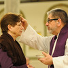 St. Monica Church opens at midnight for Ash Wednesday. Father Ray Fleming gives ashes and hears confession.