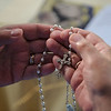 Kathy Warboys and another member of her prayer group are fighting cancer with a mixture of narcotics and prayer.