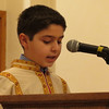 A boy reads from the Scriptures on Easter Eve at Holy Martyrs Church, Bayside, NY.