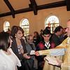 Fr. Arakel Aljalian distributes nushkhar to the faithful on Easter Sunday.  Over 800 nushkhar are distributed each year on Easter Sunday at St. James Church in Watertown, MA.