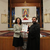 Alderwomen Shirley Saryan presenting Fr. Nareg Keutelian with the Martyrs Day proclamation from the mayor of the City of Greenfield, WI
