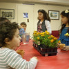Sunday School students at St. James Church of Evanston, IL, plant flowers in commemoration of Armenian Martyrs Day.