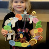 A young participant shows off her arts and crafts creation.