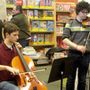 Young people play musical selections.