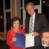 U.S. Congressman Frank Pallone presents Mrs. Sirvart Hovnanian with the Congressional citation issued in her honor.