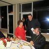 Fr. Mamigon Kiledjian and Archbishop Khajag Barsamian congratulate Mrs. Sirvart Hovnanian.