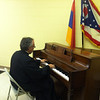 Very Rev. Fr. Simeon Odabashian plays the piano during fellowship hour in Columbus, OH.