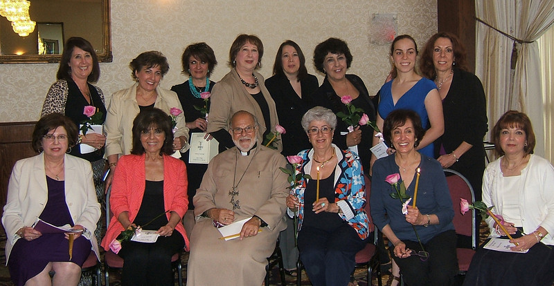Front row: Rev. Fr. Garabed Kochakian and Women's Guild chair Linda Stamboulian with new members Jacalyn Sutherland, Nevart Torian, Zabel Belian, and Carole Hovsepian. <br /> Back row, from left: Kathleen Abrahamian, Lillian Durham, Lilit Babloumian, Ann Marie Egigian, Serena Egigian, Karen Kevorkian, Erika Palaian, and Terry Palaian.