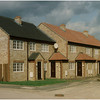 """Eight dwellings on a new """"island"""" of land on the outskirts of Ravensden village. The dangerous crossroads were altered to become a staggered junction and my Client purchased the """"island"""". It took two years and a planning appeal to win this development."""