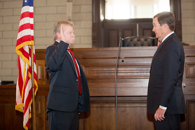 The Honorable Kirk Martin, Justice of the Peace Precinct #4, takes the Oath of office from the Honorable Graham Quisenberry, 415th District Judge. Quisenberry, an east Parker County resident, was also sworn in at the ceremony.