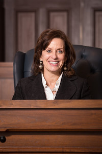 The Honorable Lynn Marie Johnson sits at her new County Court at Law #2 bench after the ceremony.