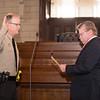 The Honorable Scott Jones, Constable Precinct #4, is sworn in by Kirk Martin, Justice of the Peace Precinct #4.