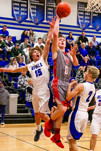 Aplington-Parkersburg's Aaron Bartels (0) goes up for the lay-up as Gladbrook-Reinbeck's Eli Thede (left) attempts a block during last Thursday's game in Reinbeck. (Jake Ryder photo)