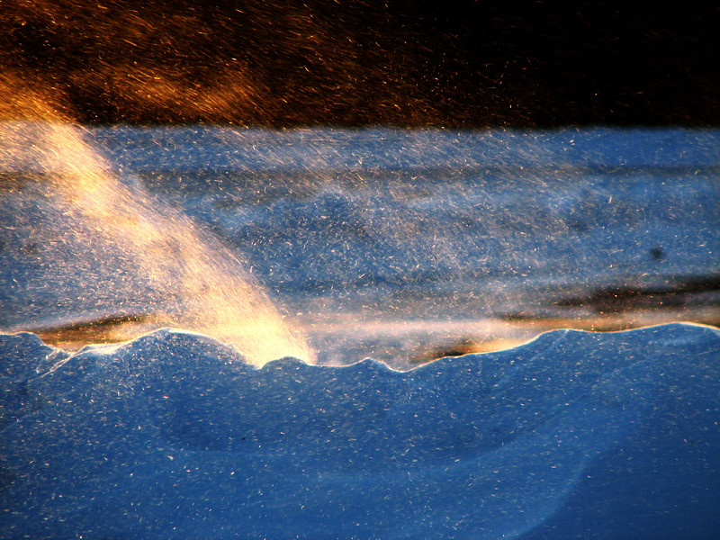 Firestorm...a close look at high winds blowing snow over a drift at sunset, Rochester NY.