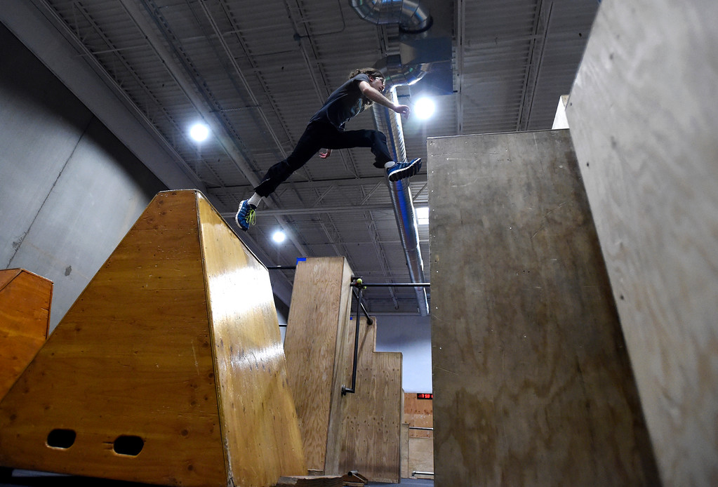 . Leo Condon leaps between obstacles during an adult Parkour class on Friday at Apex Louisville. For more photos of the workout class go to dailycamera.com Jeremy Papasso/ Staff Photographer 06/22/2018