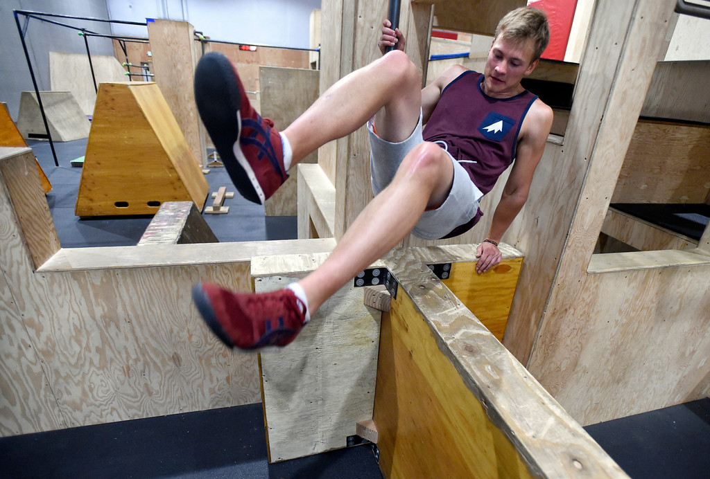 . Instructor Alex Tilmes jumps over an obstacle during an adult Parkour class on Friday at Apex Louisville. For more photos of the workout class go to dailycamera.com Jeremy Papasso/ Staff Photographer 06/22/2018