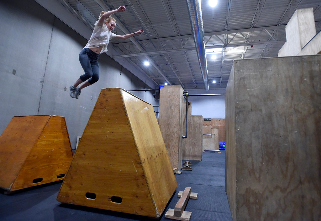. Kalliope Loudenburg jumps from an obstacle during an adult Parkour class on Friday at Apex Louisville. For more photos of the workout class go to dailycamera.com Jeremy Papasso/ Staff Photographer 06/22/2018