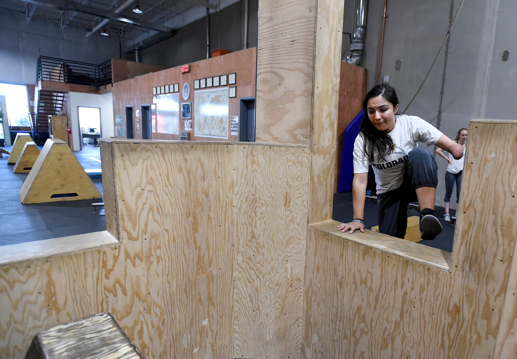 . Amanda Aguero jumps through an obstacle during an adult Parkour class on Friday at Apex Louisville. For more photos of the workout class go to dailycamera.com Jeremy Papasso/ Staff Photographer 06/22/2018