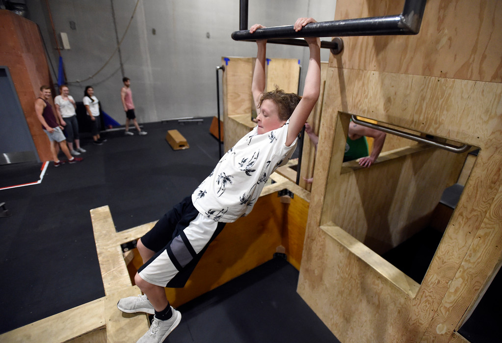 . Will Dennis swings from an obstacle during an adult Parkour class on Friday at Apex Louisville. For more photos of the workout class go to dailycamera.com Jeremy Papasso/ Staff Photographer 06/22/2018