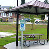 new picnic shelter at edge of basketball court