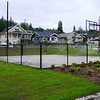 fenced basketball court at completion