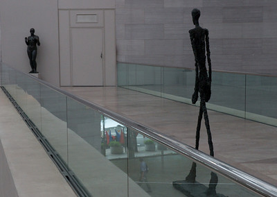 "Alberto Giacometti's ""Walking Man II"" approaching Aristide Maillol's ""Venus"" at the National Art Gallery, Washington, DC"