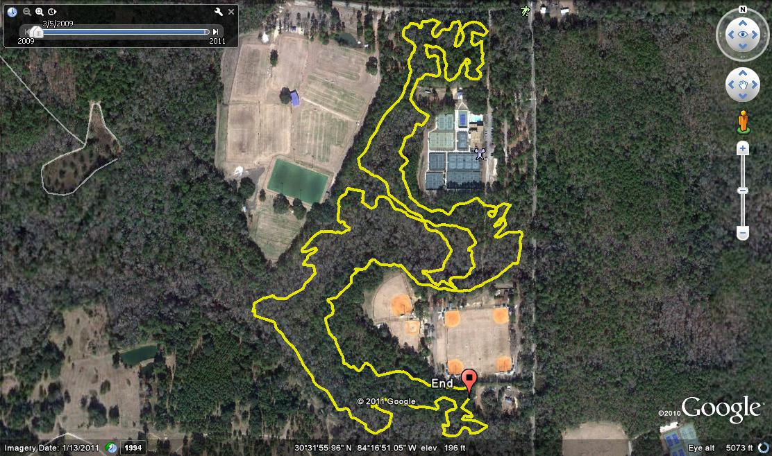 """Google Earth jpeg grab from GPS track modified yellow with GPS Visualizer. Start and stop for the anticlockwise loop were at the red """"End"""" pin. The Small Intestine section is at the top. Meadows Soccer Complex upper left, Forestmeadows Park & Athletic Center upper right, Meridian Park ball fields at the bottom. All are part of Elinor Klapp-Phipps Park."""