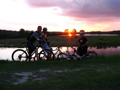1 July 2008: I tricked these guys into adding my 6.75M tack-on to the normal weekly ~15M Higher Ground Bikes Tuesday night ride. After the Alford loop, the boys posed for a East Levee sunset shot.