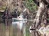 Kayak paddles along the river