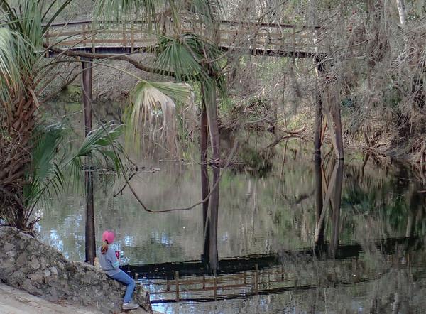 Little girl enjoys fishing