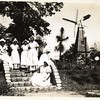 Girls Posed Near Windmill Replica (00219)