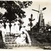 Girls Posed Near Windmill Replica (00219)