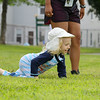 """Atherton Conklin pretends to be a caterpillar as he works with the Riverfront Children's Theatre at Michael """"Bale"""" DiConza Memorial Park  during Parks Day in Fitchburg. SENTINEL & ENTERPRISE/JOHN LOVE"""