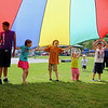 "Kids and councilors have fun playing with a Parachute at Michael ""Bale"" DiConza Memorial Park during Parks Day in Fitchburg. SENTINEL & ENTERPRISE/JOHN LOVE"