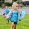 """Jean Spraque, 4, runs around acting like a butterfly as she works with the Riverfront Children's Theatre at Michael """"Bale"""" DiConza Memorial Park  during Parks Day in Fitchburg. SENTINEL & ENTERPRISE/JOHN LOVE"""